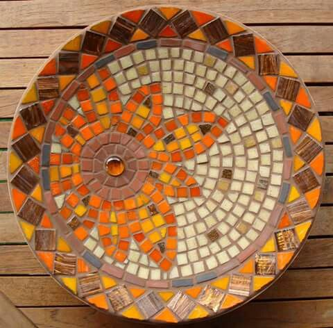 mosaic over a plate...maybe leave the rim