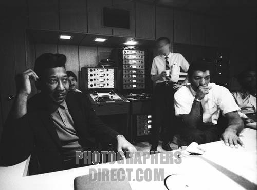 Muddy Waters at Chess recording studios at mixing desk , Chicago , 1969 . Marshall Chess , behind to the right . American blues singer , musician , born McKinley Morganfield 4 April 1915 , died 30 April 1983 . Marshall Chess , son of Leonard Chess , co founder of Chess Records .