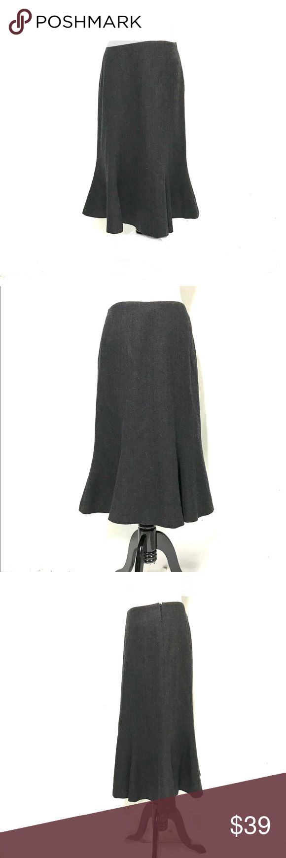 Ralph Lauren wool longer skirt. Love this shape. Fitted at the hips with more room at the lower half. Very pretty fit and flare. This is fully lined, is in like new condition and is a bigger size 4. A must have piece for fans of Ralph Lauren. Lauren Ralph Lauren Skirts Midi