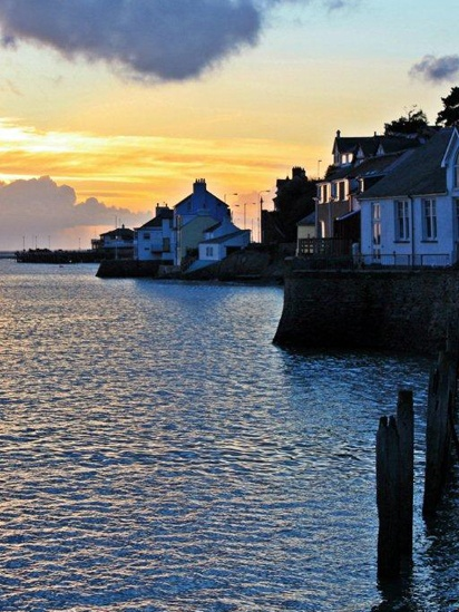 """Aberdyfi, Gwynedd, Wales.  Beneath the jetty in Aberdyfi Harbour is an art installation consisting of a bronze bell, which is rung by the water at high tide inspired by the folk song """"Clychau Aberdyfi"""".  photo credit: Barbara Fuller"""