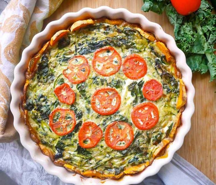 Zucchini and Kale Quiche with a Sweet Potato Crust recipe. A Paleo and GF way to enjoy a healthier version of quiche. It's filled with healthy greens, is sweetened by the sweet potato crust, and is full of protein.