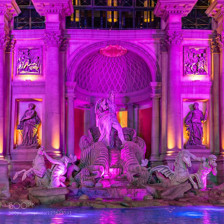 Neptun's Night Club Las Vegas offers so many opportunities for exciting night shots if one doesn't mind the many tourists swirling around all night... I hope you like my night shot of Neptun's fountain in front of Cesar Palace!