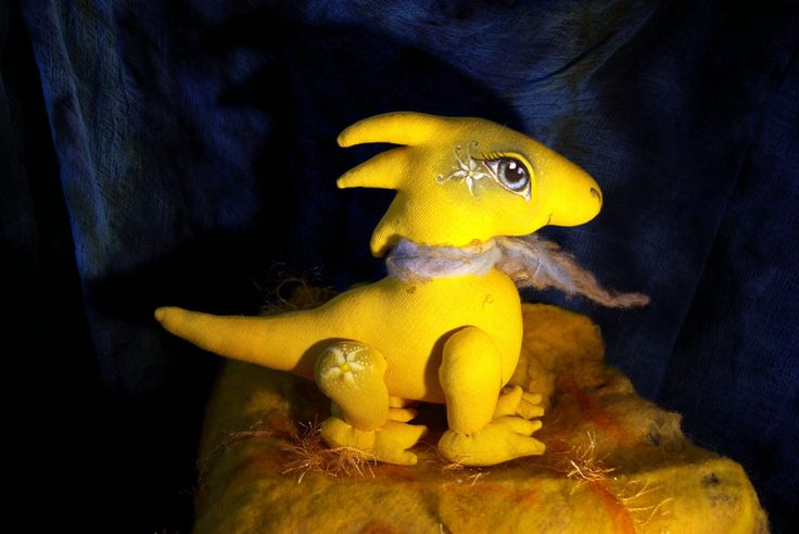Dragon - a ray of sunshine. It's a nice and friendly creature. It brings to life the sun and  the credulity of hatched chicks. It is approximately 40 cm big. Of cotton. Stuffed sheep fleece. Hand-sewn and hand-painted. Price CZK 990.