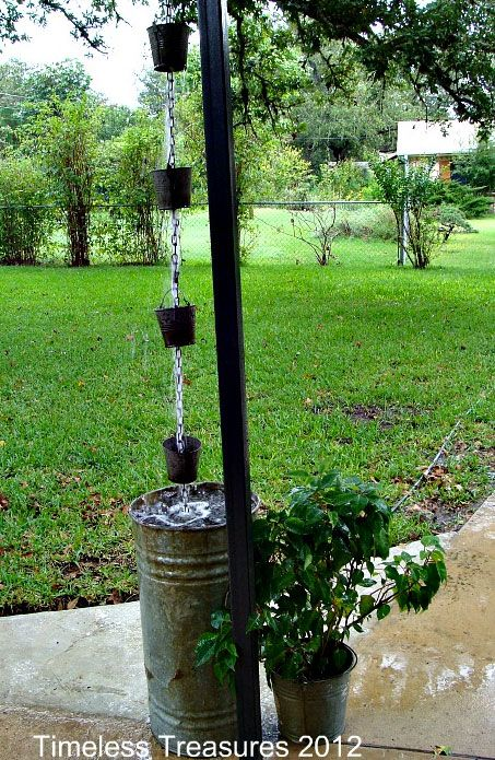 Source: Timeless Treasures  The re-purposed materials used in this rain chain would be totally at home in front of a cozy farmhouse or cabin. The small metal buckets direct water into a tall, weathered metal rain barrel where it can be collected and used to keep the garden lush and healthy.
