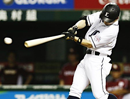Yuutaroh Ohsaki #9 delivers a dramatic 2-out, pinch-hit, walk-off single through the hole on the right side of the infield against Eagles reliever Norihito Kaneto to plate Hideto Asamura #32 from 2nd base in the bottom of the 9th inning to send the Lions a 3-2 walk-off victory over the Eagles at Seibu Dome on August 17, 2013 in Tokorozawa, Saitama.