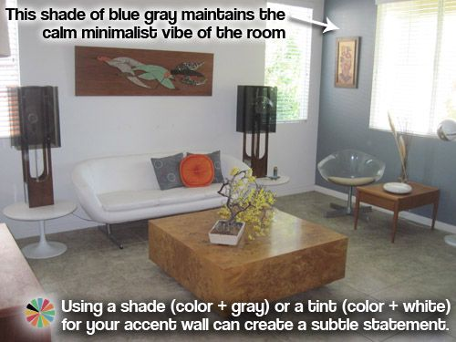Nice coffee table in retro minimalist living room with blue gray accent wall