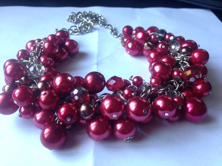 Red peals woven with clear glass stones, prepared on a silver chain