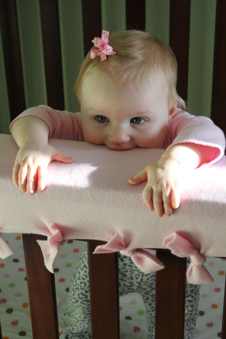 Teether/preventing baby from smashing face on hard wood crib guard!
