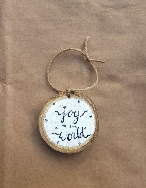 This listing is for one wood slice Christmas ornament. It is about 2.75 inches in diameter, and almost a half inch thick. Hand painted and hand lettered. Made from white poplar wood, this ornament features the saying joy to the world with little stars.  The natural bark is white with some brown spots. I have sealed this with a clear finish.   Ready to hang, or put on a gift