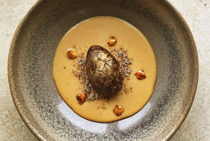 Duck & Waffle's golden egg filled with Nutella mousse, hazelnut and milk soup  #duckandwaffle #chocolate #Easter #delicious #egg #dessert #London #restaurant  http://www.squaremeal.co.uk/restaurant/duck-and-waffle