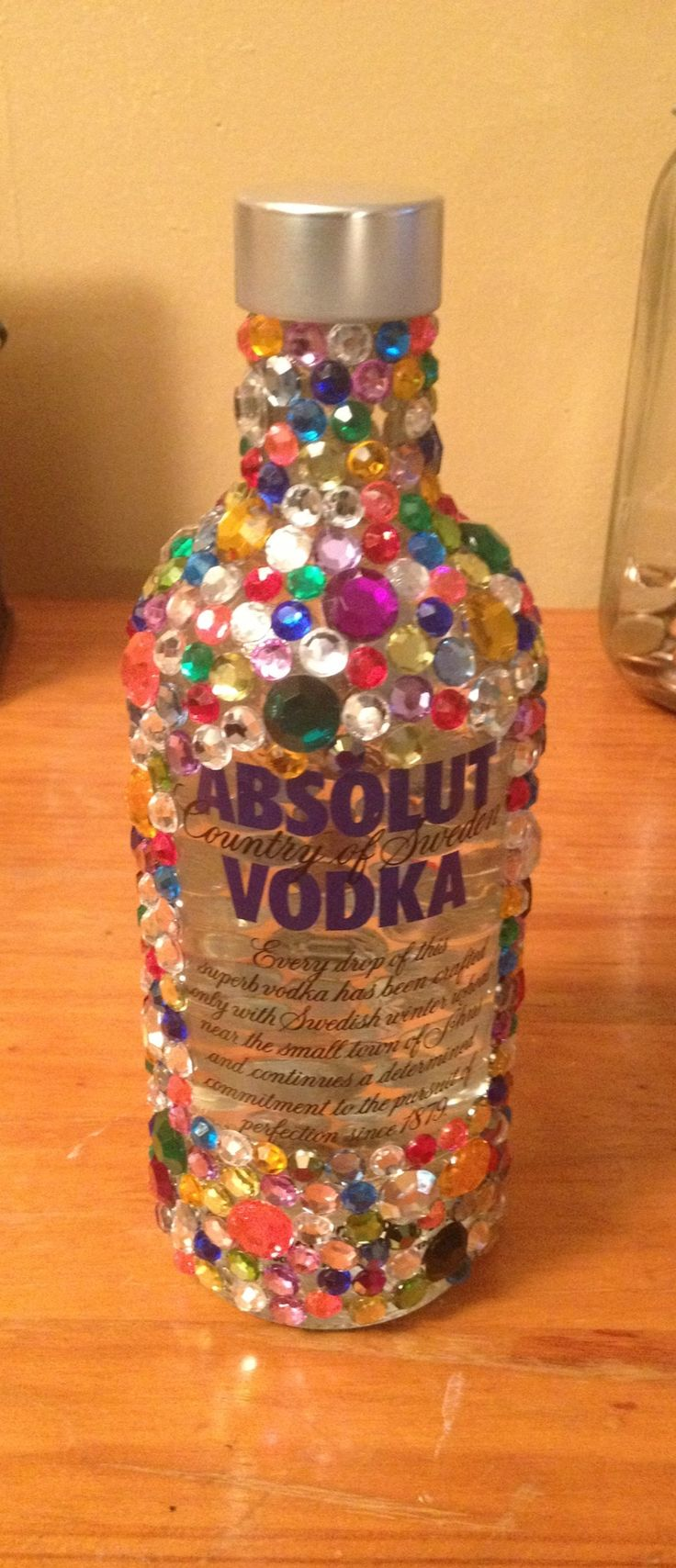 Bedazzled liquor bottle! Great as a cheap gift. I went to AC Moore & bought jewels and rubber cement glue. That's all you need!! Make sure you apply the glue in small areas on the bottle because it dries rather quick. Took me about 2 hours to make! Enjoy!! :)