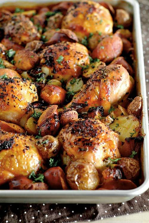 Recipe for Spanish Chicken with Chorizo and Potatoes - This really just involves throwing everything into the tray, no marinade, no cutting of various vegetables and no washing of a sink full of dishes!