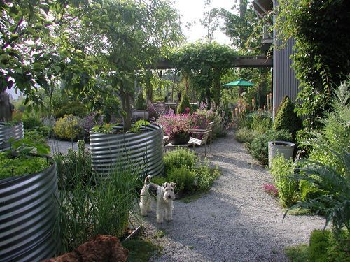 Galvanized steel container garden with gravel paths and arbors, from David Pfeiffer, Seattle landscape architect. Looks drought tolerant!