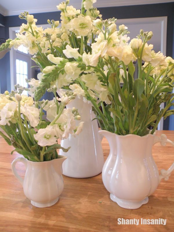 60 best images about dining room table centerpieces on for Dining table flower arrangements