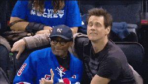 Jim Carrey and Spike Lee joking around at today's Rangers game