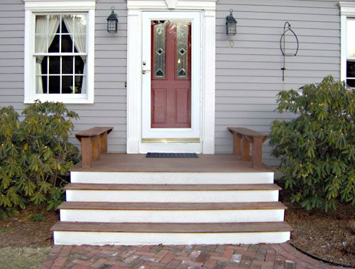 Cape cod front porch with mahogany and white steps, benches instead of side  rails