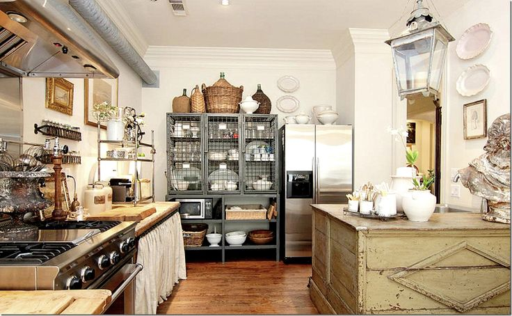 traditional country kitchen with chicken wire facing on cabinets