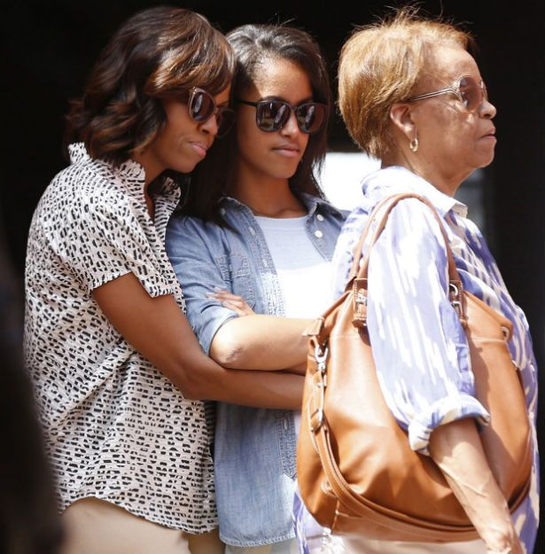 First Lady Michelle Obama, Malia and Michelle's mother Mrs. Robinson in Africa.