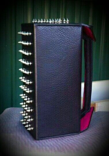 Leather clutch, tool box style with studs- ouch!