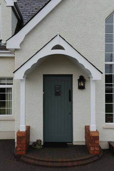 Front door canopy. Only referring to the pillars and stone