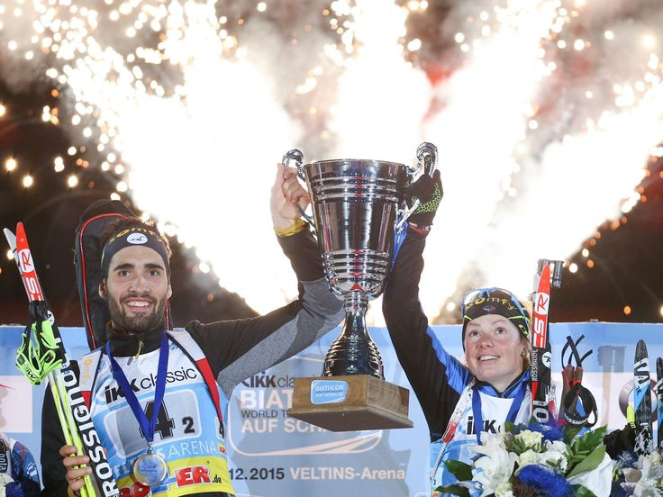France's Martin Fourcade and Marie Dorin-Habert celebrate winning the Biathlon-World-Team-Challenge (WTC) in Gelsenkirchen, Germany.  Friso Gentsch, dpa, via EPA