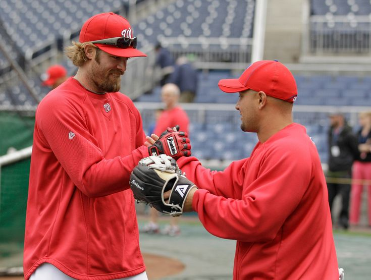 Jayson Werth and Shane Victorino Photos Photos - Jayson Werth #28 (L) of the Washington Nationals greets former teammate Shane Victorino #8 of the Philadelphia Phillies (R) before the start of their game at Nationals Park on April 13, 2011 in Washington, DC. - Philadelphia Phillies v  Washington Nationals