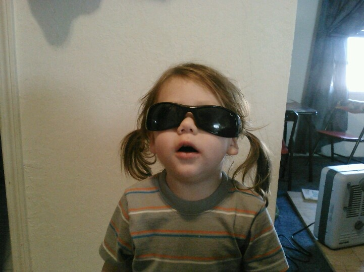 My 2 yr old wearing my sunglasses