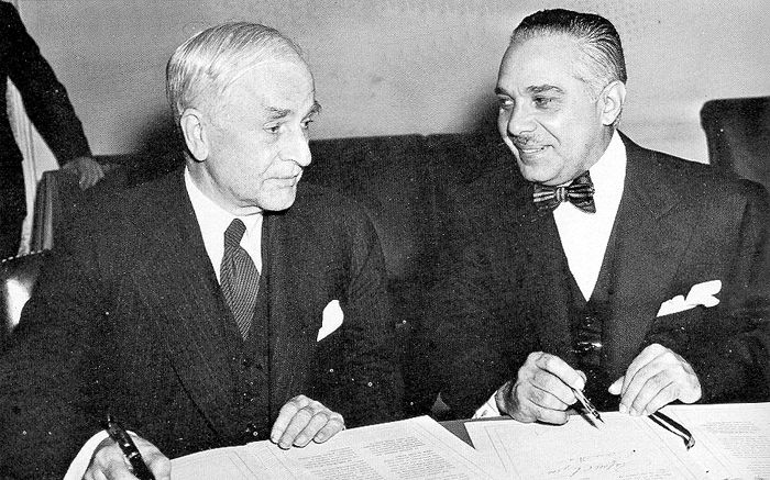 """Some of the key figures and moments from FDR's """"Good Neighbor Policy."""" In this picture, U.S. Secretary of State and Rafael Trujillo, dictator of the Dominican Republican, signing a treaty. As Europe fights against dictatorships, the U.S. was willing to work with those that showed friendly attitudes toward the U.S."""