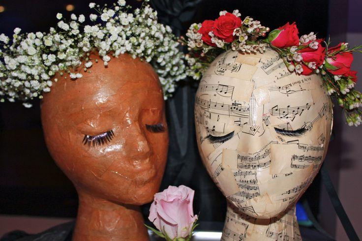 Larkspur Botanicals - Edgewater, NJ Eco-Friendly Florist displays floral headbands and floral crowns on paper mache wig mannequins.  Wedding rose floral crown.  Wedding Baby's Breath Floral Crown