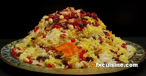 Persian Jeweled Rice (Javaher Polow). This fabulous recipe fit for an emperor uses oranges, berries, raisins, almonds and pistachios, cumin seeds, dried rosebuds, cardamom pods. Well worth the effort for a special occasion!