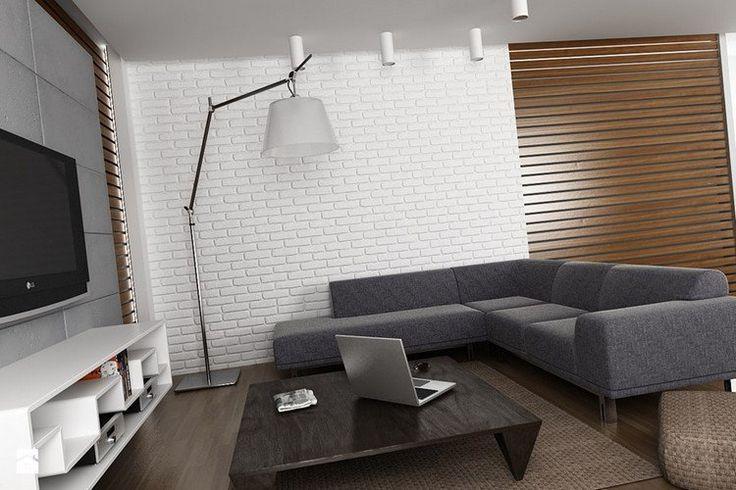 canapé gris chin, revêtement mural en brique blanche et lampadaire design
