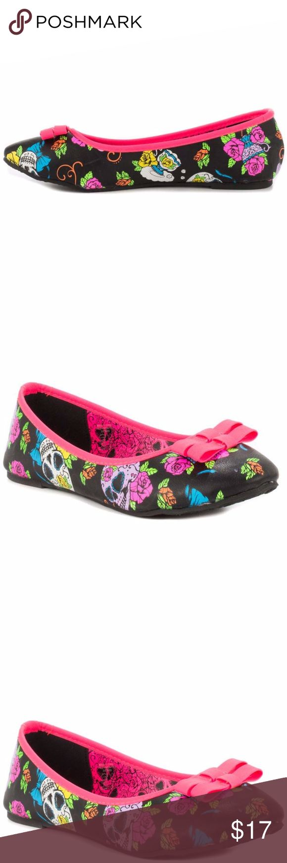 Iron Fist Sweet Tooth Flats You might get a cavity from the Sweet Tooth! These Iron Fist flats feature a black synthetic leather with skull and floral print. Bright hot pink piping, and double bow contrast perfectly to this colorful look. Brand new, never worn! Iron Fist Shoes Flats & Loafers