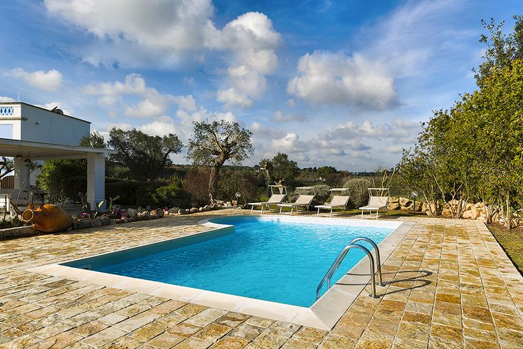 Villa Blu - Essential Italy    In the rolling fields just outside the beautiful town of #Ostuni, this vast 5-bedroom villa lies in spacious grounds with private pool. Sleeps 10.     #luxuryvilla #familytravel #luxurytravel #villaholidays #villasinpuglia #puglia #holidaysinitaly #groupholidays #italy