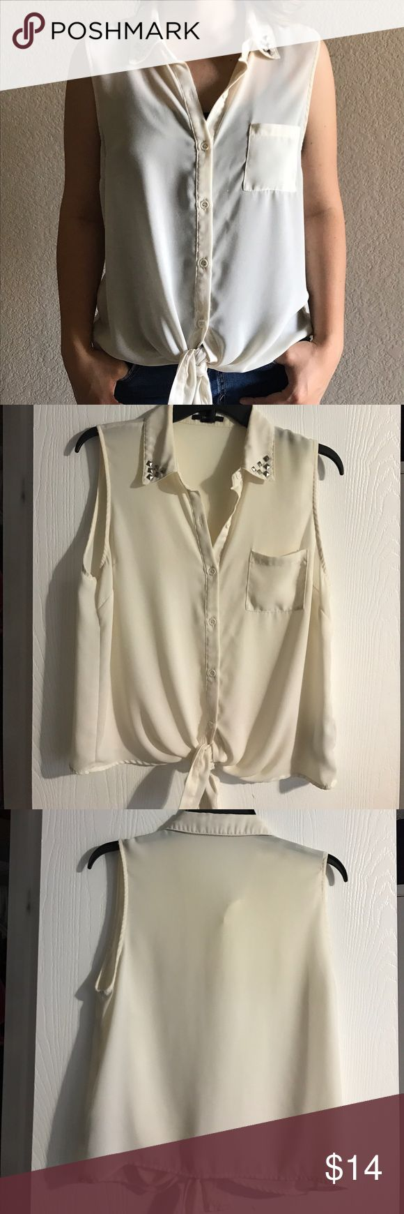 White Tank Top With Studded Collar This white and loose flowing tank top/ blouse, is made to tie together in the front and Studded along the collar. It is slightly sheer so you can pair this top with a white cami or go for a bolder look and try adding some color! Forever 21 Tops Tank Tops