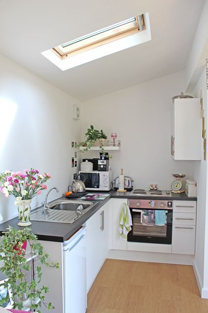 A cute corner kitchen in our Granny Annexe in Worthing. Plants and flowers brighten up the space. www.grannyannexe.com  ~ Great pin! For Oahu architectural design visit http://ownerbuiltdesign.com