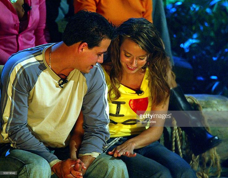 Survivor All-star cast members 'Boston Rob' Mariano and Amber Brkich look at Amber's engagement ring after Rob proposed marriage and Amber accepted on the set of the Survivor All-stars Finale at Madison Square Garden May 9, 2004 in New York City.