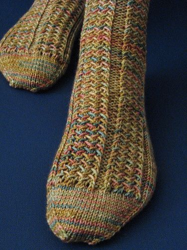 herringbone rib socks- free pattern. I've knit these before and loved how they fit, but they ended up felting and shrinking... :( will have to redo them!