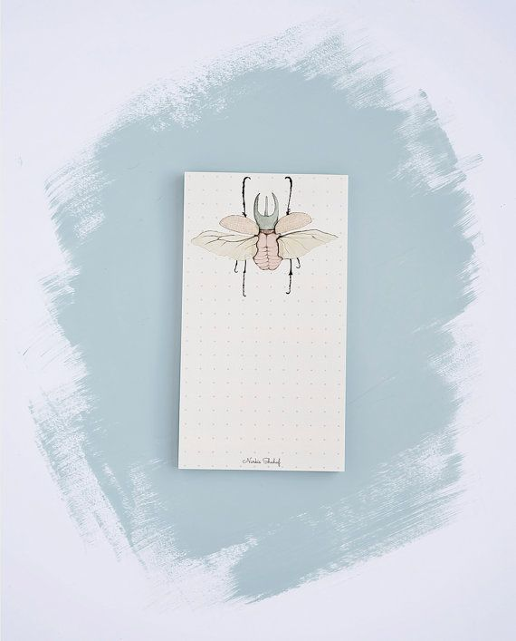 A 50 tear-away paper memo notepad of striking beetle illustrations in soft pastel colors and an captivating botanic feel.  *50 tear-away sheets