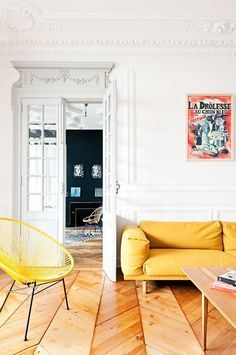 Home design ideas / Home inspirations |  Colorful 19th-Century Modern French Apartment located in the historic centre of Bordeaux, France.The yellow leather sofa and yellow armchair get a modern touch to the apartment.