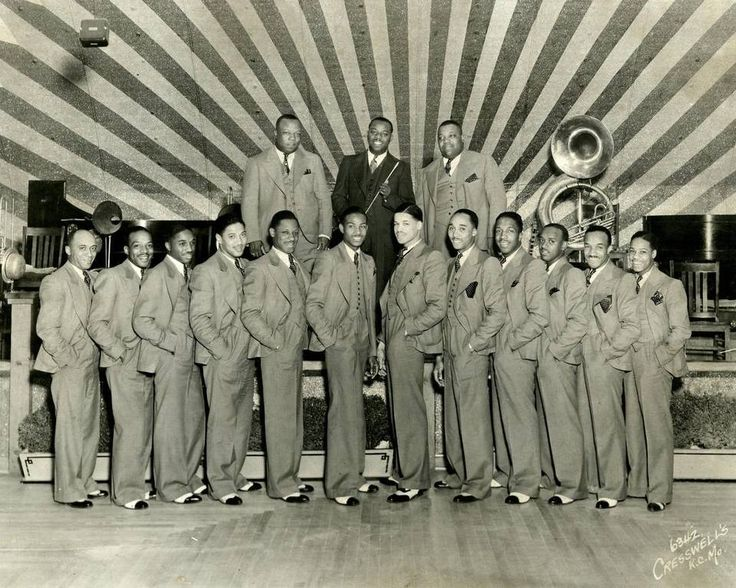 """The Bennie Moten Orchestra (shown at Fairyland Park about 1931) was one of the most successful jazz bands in the Midwest. Left to right in front: Vernon Page, Count Basie, Orin """"Hot Lips"""" Page, Ed Lewis, Thamon Hayes, Eddie Durham, Woodie Walder, Leroy """"Buster"""" Berry, Harlan Leonard, Booker Washington, Willie McWashington, Jack Washington. Left to right in rear: Bennie Moten, Buster Moten, Jimmy Rushing. (Basie took over the band after Moten's death in 1935.)"""