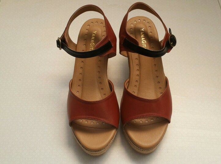 Gayatri in brown leather