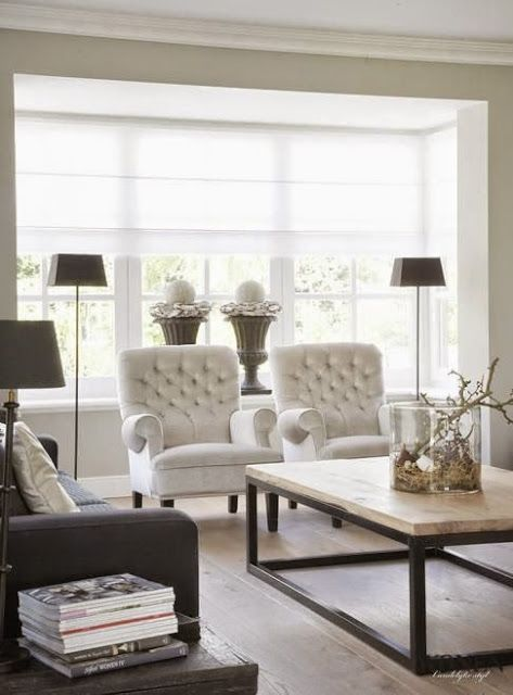 beautiful traditional neutral family room with floor lamps