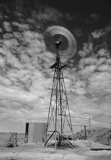 Photo by David May - windmill, water, turkeys, nest, outback, film, speed, spinning, clouds, vertical, portrait, copyspace, australia, northern, territory,