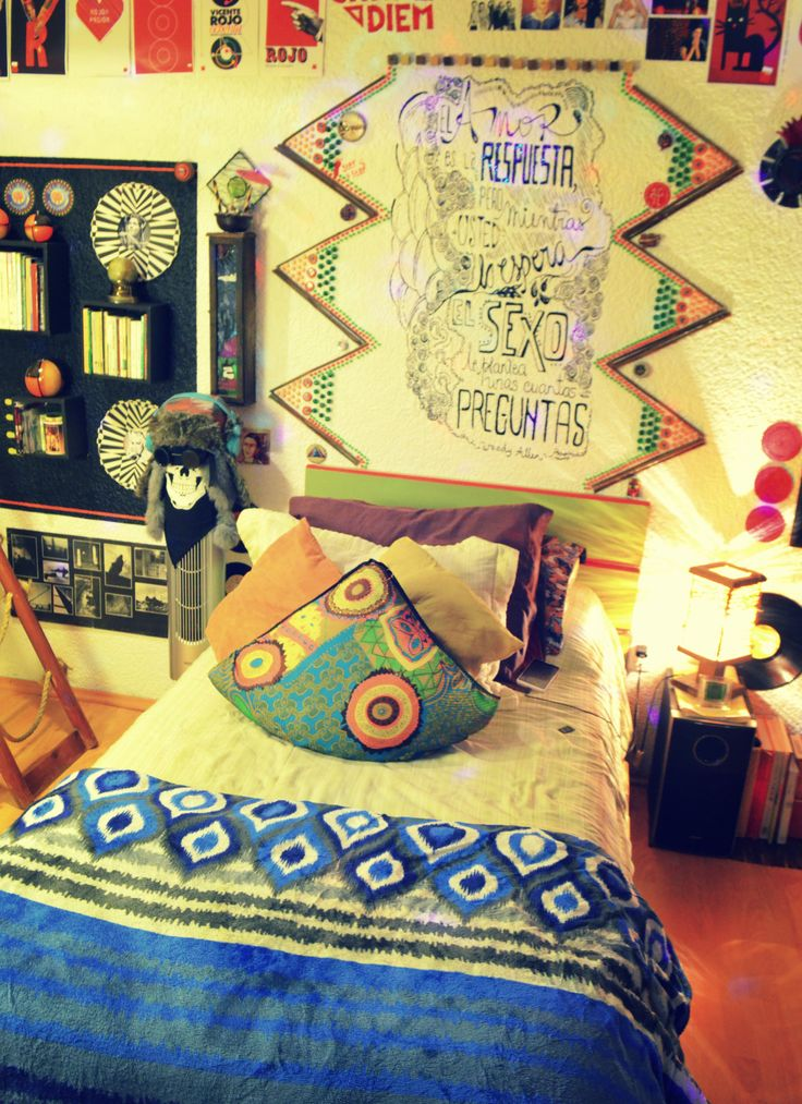 """""""The Bed""""  This is one of the most attractive parts of the room. I made the triangles of the top of the bed with pieces of bamboo, marbles of different sizes and I painted that phrase of Woody Allen with SO MUCH patience."""