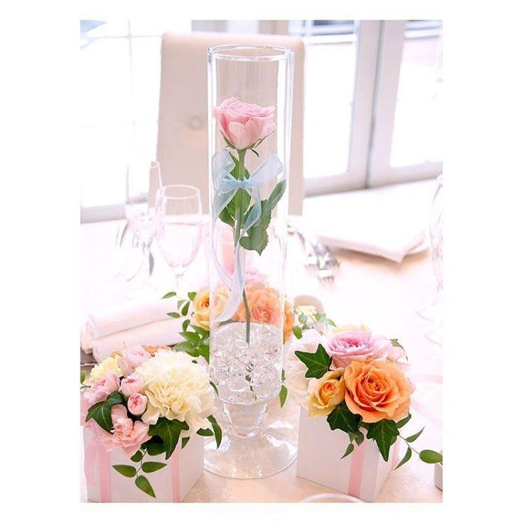 . . 愛を誓う結婚式にぴったりの装花 バラの花を細いガラスの筒に入れた装花は とってもロマンチックで印象的♡ 情熱の赤いバラも素敵だけど、 優しい色合いのピンクも可愛くてとっても素敵! . #flowerwalkpopo #富山県 #花嫁準備 #プレ花嫁 #結婚式準備 #結婚式 #ウェディング #テーマウェディング #オリジナルウェディング #キャナルサイドララシャンス #ララシャンス#花屋 #花 #ゲスト装花 #ゲストテーブル装花 #かわいい #ピンク #ラブリー #虹色 #ブライダル #wedding #weddingflowers #bride #bridal #bridalflowers #instflower #flowerstagram #flowerpic#lovely