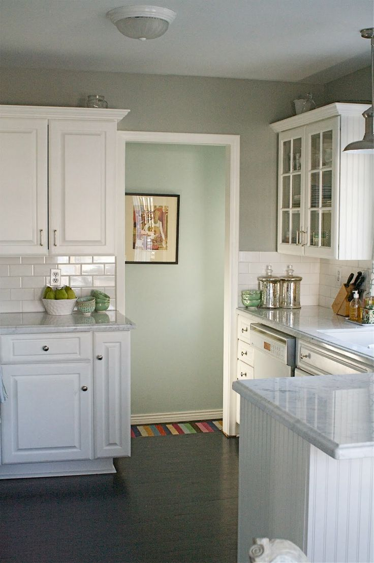 Love how the paints colors for the kitchen gray the White cabinets grey walls