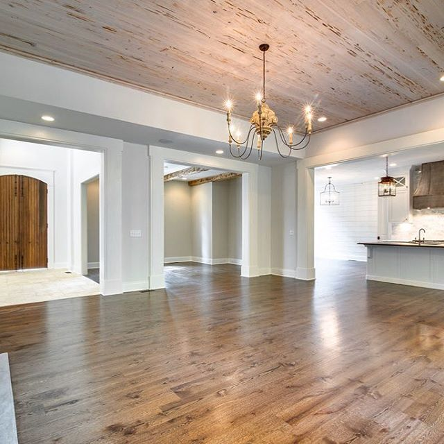 An Open Living White Kitchen And Pecky Cypress
