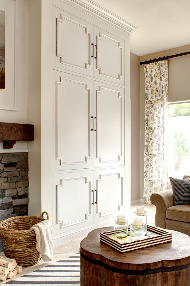 Love the moldings  beautiful cabinet doors over living room built-ins to hide TV & electronic components, etc.