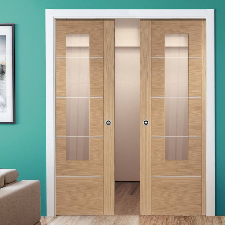 Double Pocket Portici Oak Flush Door, Aluminium Inlay & Clear Glass, Prefinished. #contemporarypocketdoors #contemporaryslidingdoors #contemporaryoakdoors