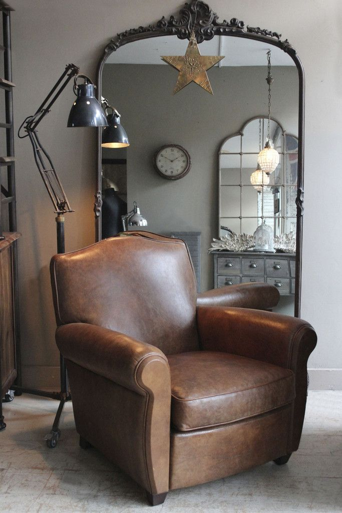 the vignette of the big (almost over-sized) mirror, the industrial lamp and the club chair